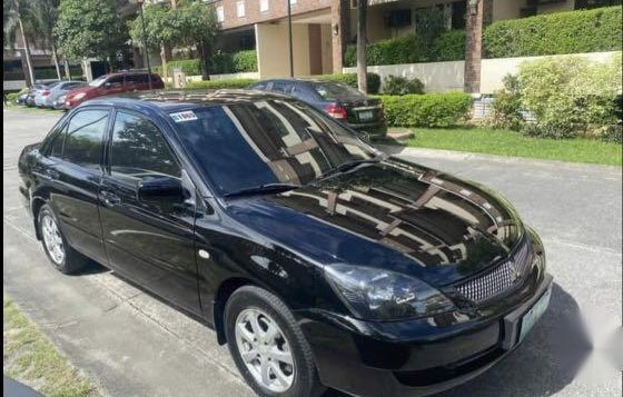 Black Mitsubishi Lancer 2011 for sale in Quezon